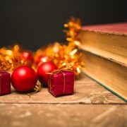 Book with christmas decoration on wooden table.